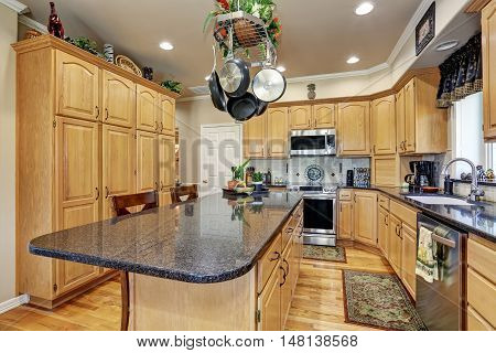 Kitchen Room Interior In Luxury Home With Maple Cabinets.