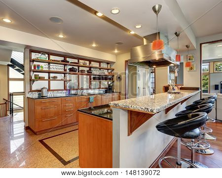 Kitchen Interior With Long Wooden Cabinets And Shelves.