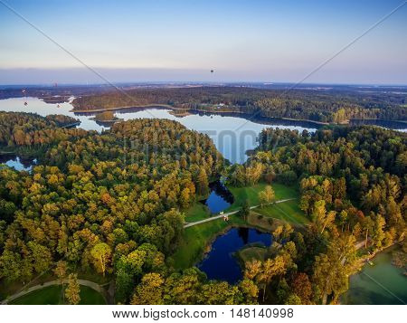 Aerial UAV top view of lakes next to Trakai and Vilnius, Lithuania in the sunset of autumn
