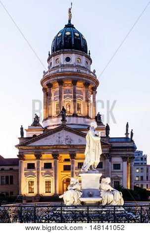 Panoramic Gendarmenmarkt square with German Cathedral in golden evening light at sunset with clouds, Berlin Mitte district
