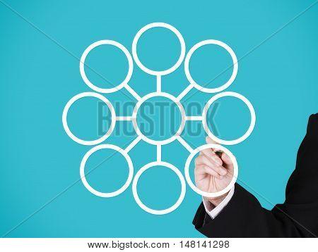 businessman writing on blank circular marketing network blue background