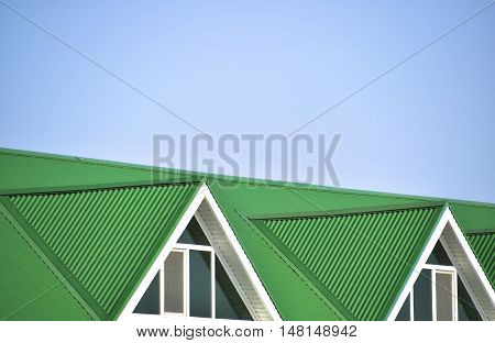 The House With Plastic Windows And A Green Roof Of Corrugated Sheet
