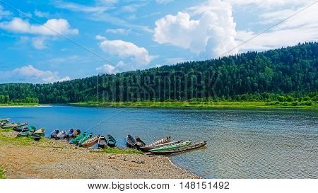 Beautiful river landscape with boats moored to the bank of the river. Beautiful river landscape.