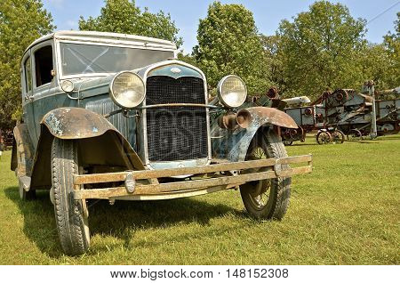 ROLLAG, MINNESOTA, September 1, 2016: The front of an old Model T Ford automobile is displayed amongst the threshing machines at the West Central Steam Threshers Reunion in Rollag, MN attended by 1000's held annually on Labor Day weekend.