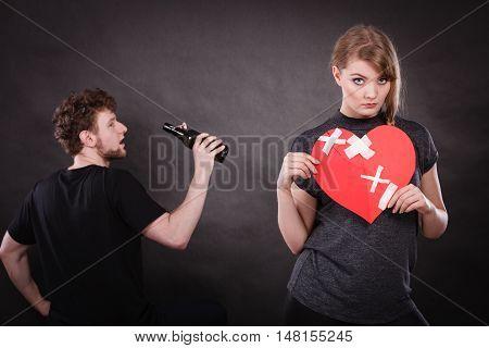 Sad Woman And Man Addicted To Alcohol. Broken Heart.