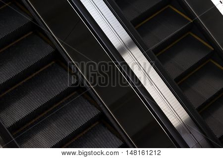 Escalator close up in modern building. architecture concept. Black and white photo.