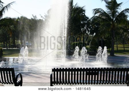 Park Benches By The Large Fountain