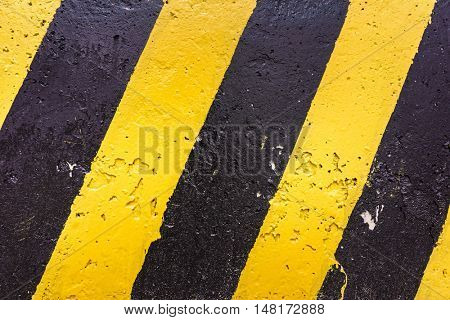 Grunge Black And Yellow Stripes Surface As Warning Or Danger Pattern, Old Concrete Textured, Danger Sign Background. Industrial Striped Road Warning Yellow Gray Texture Pattern
