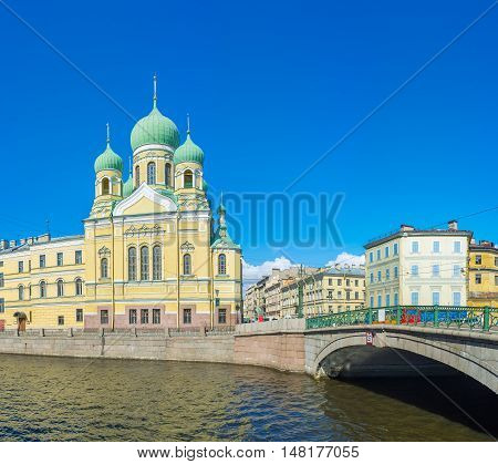 The Lermontovsky Bridge leads to the St Isidore Church located at the bank of Griboedov Canal St Petersburg Russia.