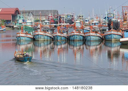 RAYONG THAILAND - APRIL 12 : local fishery boat approaching in rayong river port important sea food market place in eastern thailand on april 12 2016 in rayoung province thailand