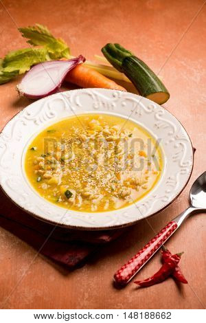 spicy spelt soup with zucchinis carrots and onions