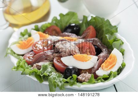 Salad Nicoise with bolied eggs, tuna, anchovy and olives