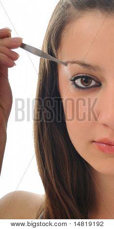 young girl cosmetic beauty isolated eye brow tweezer treatment