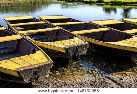 Boats Anchored In A Lake Shore