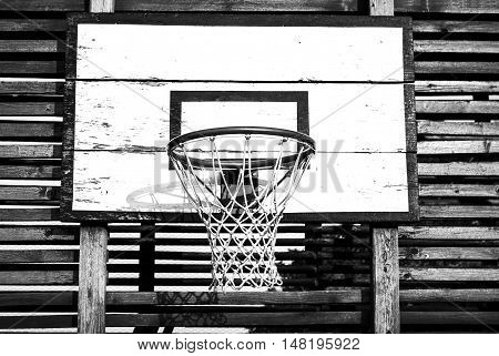 Basketball Backboard and Net In The Yard