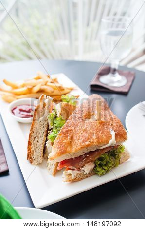 chicken club house sandwich with french fries