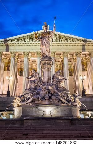 Austrian Parliament Building At Night landmark of Vienna with Pallas Athena Fountain in front