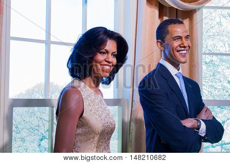 BANGKOK THAILAND - DECEMBER 19: A waxwork of Barack and Michelle Obama on display at Madame Tussauds on December 19 2015 in Bangkok Thailand