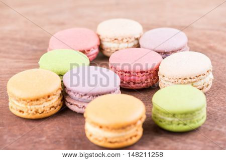 Colorful macaron on wooden background  close up