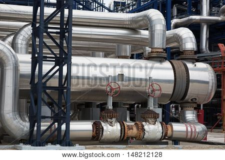 Close-up of pipelines and destillation tanks of an oil-refinery plant