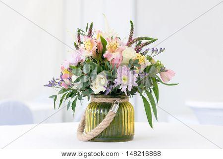 Beautiful Flower Arrangement On White Festive Table