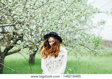 Stylish Spring Bohemian Outfits. Wearing A White Sweater And Bla