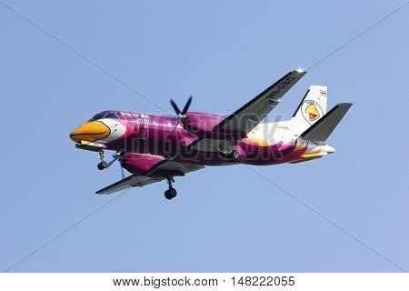 CHIANGMAI, THAILAND -JANUARY 7 2013: HS-GBG Saab340 of Nokmini airline ( Nokair) , landing to Chiangmai airport from Maesot,Tak provice. Service short route in thailand and around.
