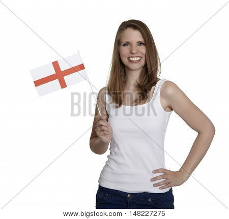 Attractive woman shows flag of England and smiles in front of white background