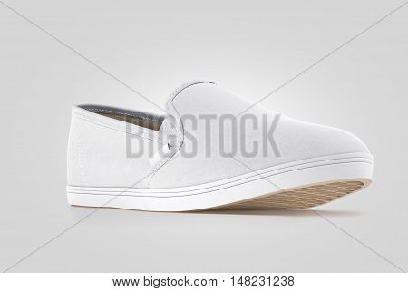 Blank grey slip-on shoe design mock up isolated clipping path 3d rendering. Plain hipster slipon mockup template stand profile view. Urban skate boot with clear label presentation.