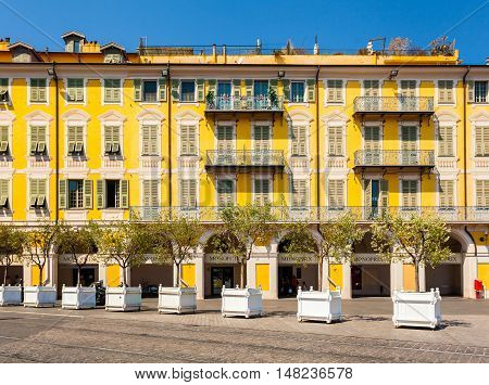 NICE, FRANCE - AUGUST 28, 2016: The yellow building in Garibaldi square. The old town of Nice, France