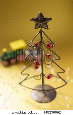 A Christmas tree made of wire and a choo-choo train