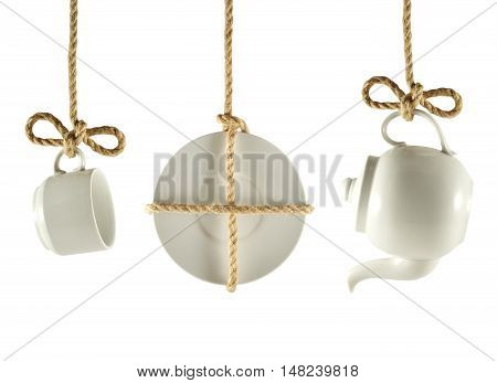 Dishes hanging on the ropes isolated on white background