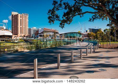 Adelaide Australia - September 11 2016: Adelaide city skyline viewed across the foot bridge in Elder Park on a bright day