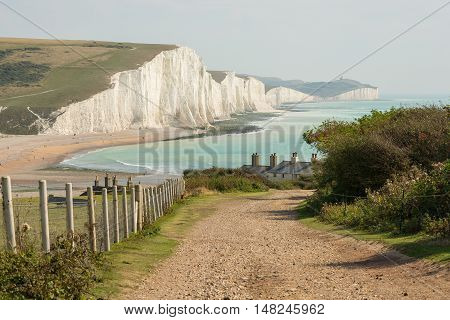 View towards the Seven Sisters chalk cliffs and Beachy Head from Seaford Head. East Sussex England