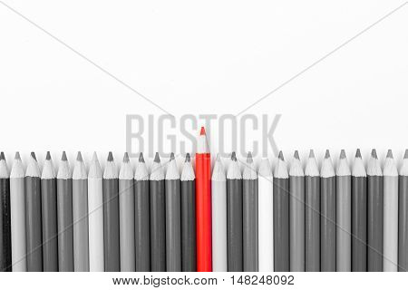 Red Pencil Standing Out From Monochrome Pencils Crowd