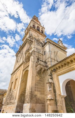 Cordoba Andalusia Spain - April 20 2016: The bell tower Alminar of Mosque of Cordoba converted to a Cathedral in the 1500 Andalusia Spain. The Great Mosque of Cordoba is made up of Arab-Islamic and Gothic and Renaissance architecture art.