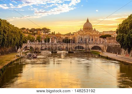 Daily view of San Pietro Saint Peter basilica with Sant'Angelo bridge and Tevere river in Rome Italy