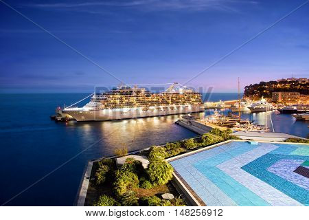 Monte Carlo, Monaco - October 07, 2014: Oceania Cruises ship Marina  docked at port of Monte Carlo, Monaco on October 07, 2014. Marina blends sophistication with a contemporary flair to create a casually elegant ambiance