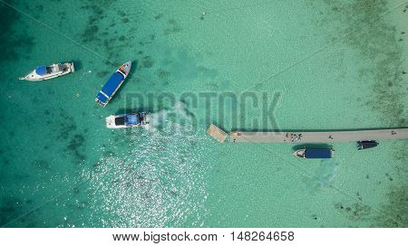 top view of speed boat approaching to jetty over clear blue sea water racha island phuket thailand