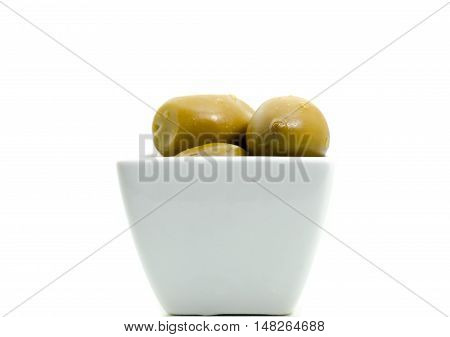 Kalamata greek green olives with water drops in white small bowl isolated on white