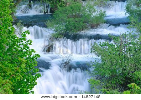beautiful nature scene with river and waterfall at spring seasson poster