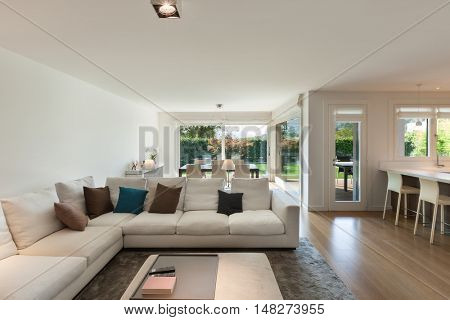 living room of luxury house, comfortable divans