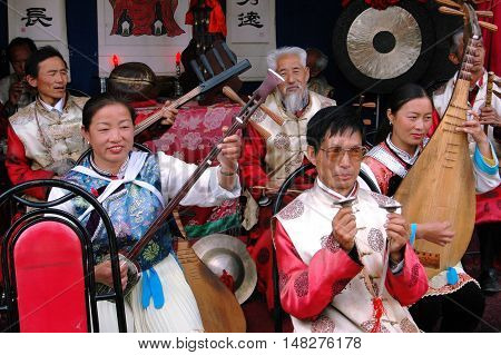 Lijiang China - April 19 2006: Naxi musicians using ancient Chinese instruments performing in concert at the historic House of Mu
