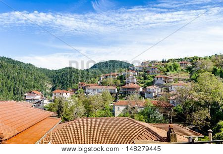 House and roofs of Baltessiniko village under blue sky. Arcadia Peloponnese Greece
