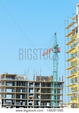 Working tower crane on a background sky