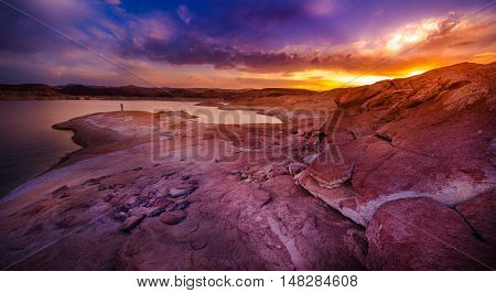 Woman taking picture with smartphone Lake Powell at Sunset Utah