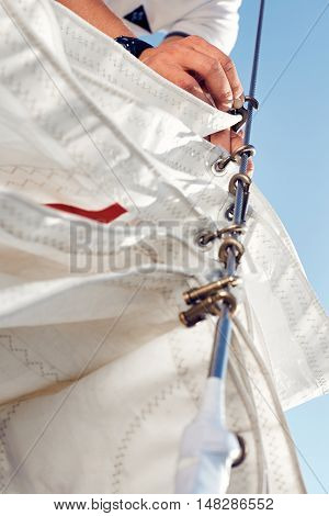 Preparing before lifting staysail sails. Before going out into the sea