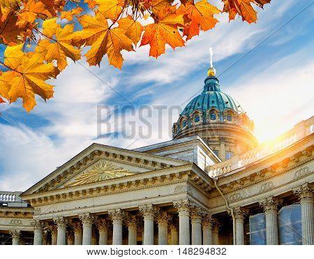 St Petersburg, Russia.Closeup of Kazan Cathedral in St Petersburg. Kazan Cathedral framed by autumn leaves in St Petersburg Russia at the sunset . Soft focus applied. Architecture landscape of St Petersburg landmark