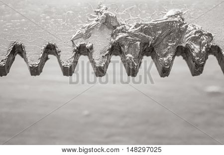 Closeup grease for lubrication at the old metal gate of house textured background in black and white tone