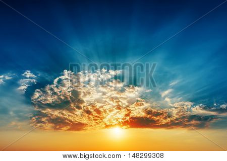 good sunset in clouds and sunrays over it